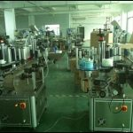Transparent film labeling equipment for round bottles automatic vertical two side labeler machine