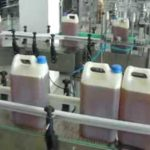 Automatic Jerry can, bucket, barrel filling machine liquid filling capping and labeling machine