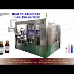 high speed sticker labeling machine for small bottles|YQ machinery rotary labeling equipment