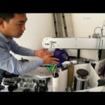Double side labeling machine video for machine oil flat bottle front back sides label applicator