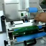 Semi-automatic paste labeling machine for round bottles with paper label manual wet glue labeler