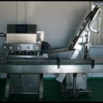 Fully automatic pet bottle capping machine with cap feeder screw capper video