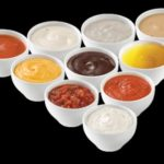small glass jar sauce/ jam /paste feeding  filling and capping with cap sorter two heads filler line