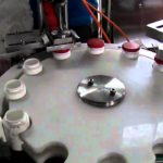Automatic capping machine for round jars with pneumatic type cap screwing system