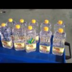 Automatic three sides labeling machine edible oil bottles labeler for indonesians
